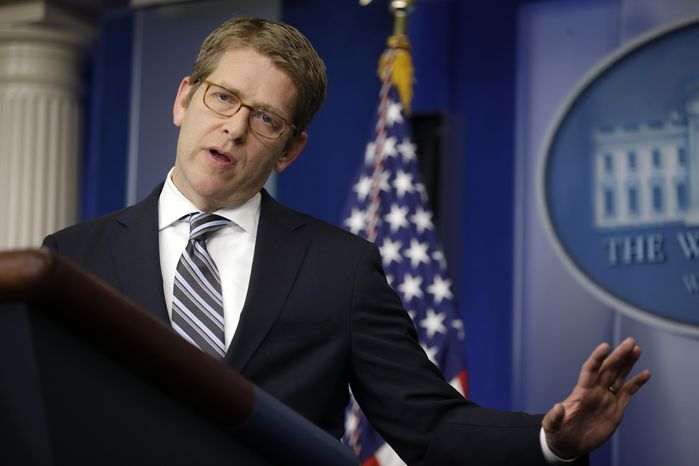 ** FILE ** White House spokesman Jay Carney answers questions during his daily news briefing at the White House in Washington on April 1, 2013. (Associated Press)