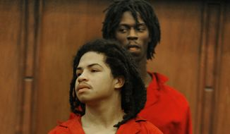**FILE** Eric Rivera Jr., 17, front, and Jason Scott Mitchell, rear, walk into a courtroom, Friday, Dec. 21, 2007, in Miami. The two suspects from the Fort Myers, Fla. area are charged with breaking into Redskins Pro Bowl safety Sean Taylor's Miami home Nov. 26 and shooting him during a confrontation in his bedroom. (AP Photo/Alexia Fodere, Pool)