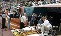 Miami Dolphins quarterback Pat White is carried out on a cart after an injury during an NFL football game against the Pittsburgh Steelers in Miami Sunday, Jan. 3, 2010. (AP Photo/Lynne Sladky)
