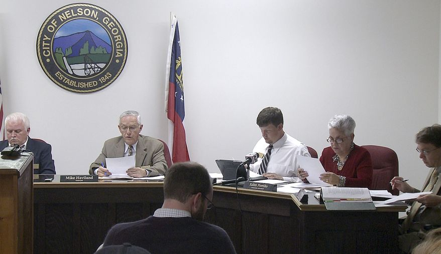 In a photo made from video, the Nelson, Ga., City Council meets to vote on a mandatory gun ownership ordinance for all heads-of-household, Monday, April 1, 2013, in Nelson, Ga. Left to right: Council member Jackie Jarrett, Mayor Mike Haviland, council member Duane Cronic, council member Edith Portillo and city attorney Jeff Rusbridge. (AP Photo/Johnny Clark)