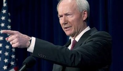 National School Shield Task Force director Asa Hutchinson speaks during a news conference at National Press Club in Washington on April 2, 2013. The National School Shield program is a framework to arm security guards in any school system who want to be part of the program. (Associated Press)