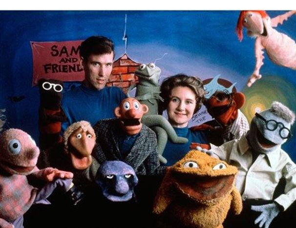 Jane Henson with Jim Henson and the cast of Sam and Friends, Washington, DC, c. 1960. Photo by Del Ankers. (c) The Jim Henson Company. All Rights Reserved. Copyright (c) Disney.