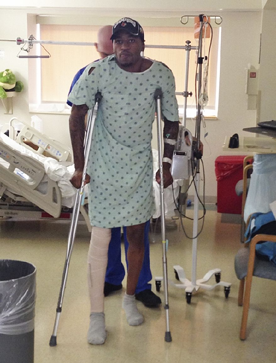 In this photo released by the University of Louisville, basketball player Kevin Ware walks on crutches, Monday, April 1, 2013, in Louisville, Ky. Ware broke his leg in the first half of Sunday's Midwest Regional final when he landed awkwardly after trying to contest a 3-point shot, breaking his leg in two places. He was taken off the court on a stretcher as his stunned teammates openly wept. His teammates went on to defeat Duke 85-63 to reach their second straight Final Four. (AP Photo/University of Louisville,)