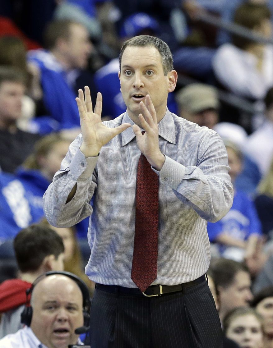 Rutgers head coach Mike Rice reacts to play during the second half of an NCAA college basketball game against Seton Hall, Friday, March 8, 2013, in Newark, N.J. Rutgers won 56-51. (AP Photo/Mel Evans)