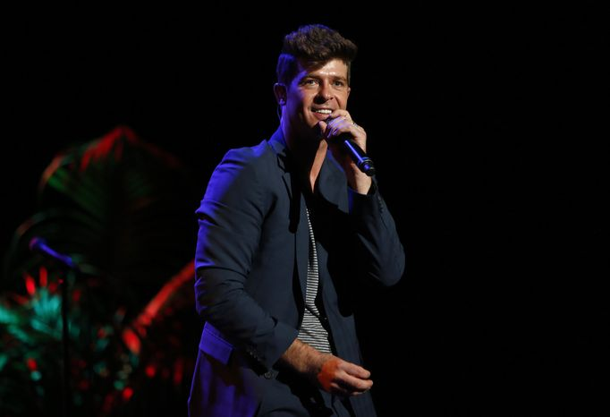 "Singer Robin Thicke performs at the ""Voices on Point"" concert and gala in Los Angeles on Saturday, Sept. 1"