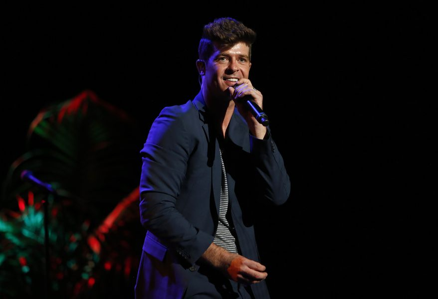 "Singer Robin Thicke performs at the ""Voices on Point"" concert and gala in Los Angeles on Saturday, Sept. 15, 2012. (AP Photo/Point Foundation, Colin Young-Wolff)"