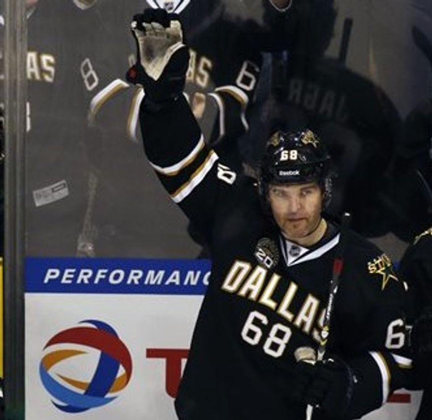 Dallas Stars forward forward Jaromir Jagr (68) waves to the fans as he received a standing ovation during the third period of an NHL hockey game against the Minnesota Wild Friday, March 29, 2013, in Dallas, Texas. Jagr got his 1000th assist during the game. (AP Photo/Sharon Ellman)
