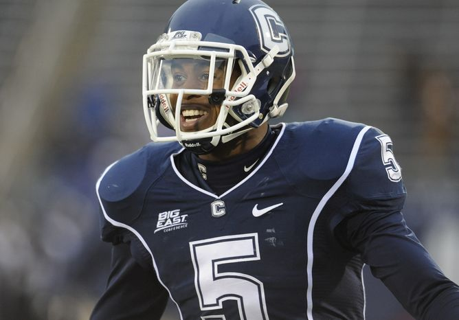 Connecticut cornerback Blidi Wreh-Wilson (5) warms up before an NCAA college football game at Rentschler Field in East Hartford, Conn., Saturday, Dec. 1, 2012. (AP Photo/Jessica Hill)
