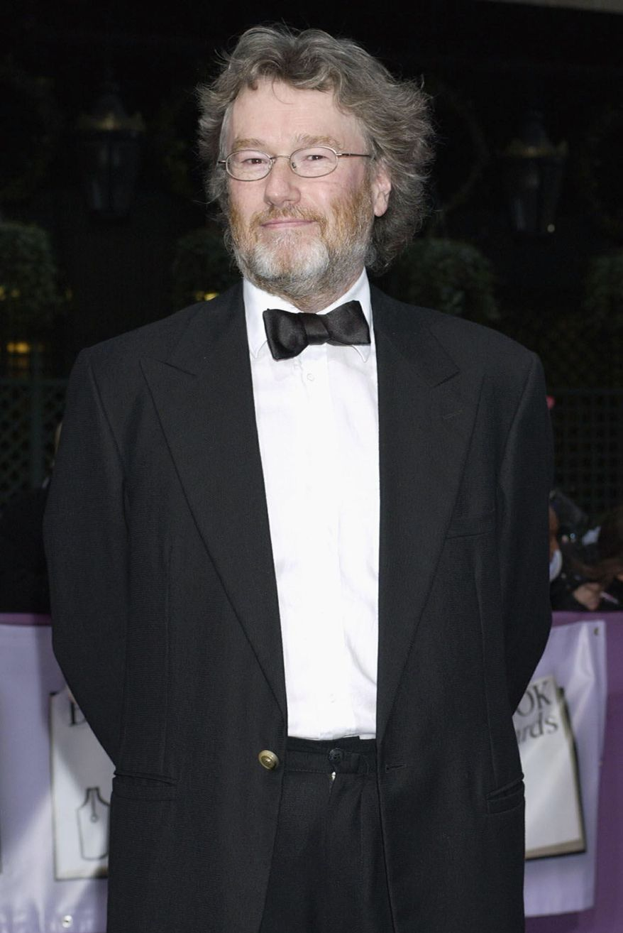 ** FILE ** Scottish author Iain Banks, pictured in 2004, has been diagnosed with late-stage gall bladder cancer and has just months to live. (AP Photo/Yui Mok, Press Association)
