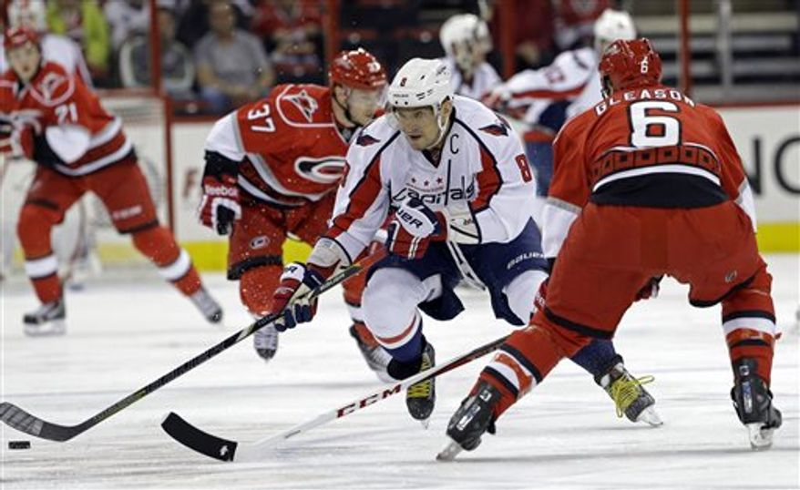 Washington Capitals' Alex Ovechkin (8), of Russia, skates against Carolina Hurricanes' Tim Gleason (6) during the first period of an NHL hockey game in Raleigh, N.C., Tuesday, April 2, 2013. (AP Photo/Gerry Broome)