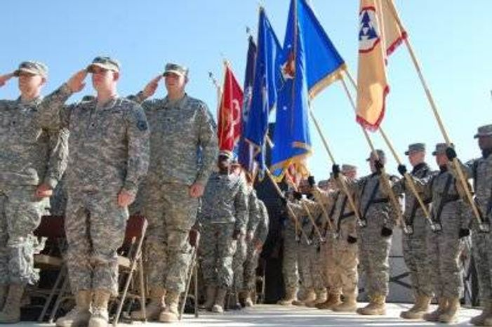 ** FILE ** Soldiers and members of a joint color guard at Fort Knox take part in a c