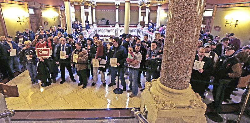 Gun rights advocates fill the hallways of the Capitol in Hartford, Conn., on Wednesday as the state Senate took up gun control bill. The body passed the legislation and sent it on to the state House, which was expected to approve it and send it on to the governor. (Associated Press photographs)
