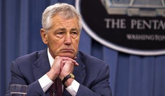 **FILE** Defense Secretary Chuck Hagel listens during a news conference at the Pentagon on March 28, 2013. (Associated Press)