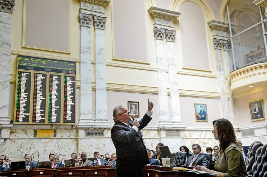 Delegate Anthony J. O'Donnell, Southern Maryland Republican, (above) discusses gun control legislation Wednesday before the House of Delegates voted to approve a bill that will make the state's regulations among the strictest in the country. (Andrew Harnik/The Washington Times)