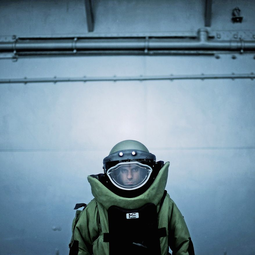 U.S. Air Force Explosive Ordnance Disposal (EOD) technician Staff Sgt. Salvatore DiGiacomo demonstrates use of the EOD 9 bomb suit. Air Force Sgt. Jeremy T. Lock has won top military photographer of the year honors seven times. (Sgt. Jeremy T. Lock)