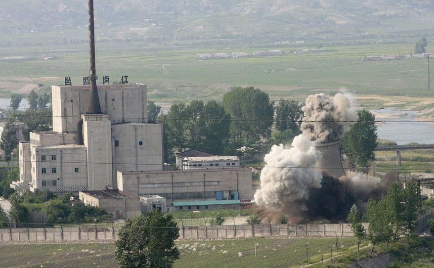 In this June 27, 2008, file photo released by China's Xinhua News Agency, the cooling tower of the Yongbyon nuclear complex is demolished in Nyongbyon, also known as Yongbyon, North Korea, in a sign of its commitment to stop making plutonium for atomic bombs. (AP Photo/Xinhua, Gao Haorong, File)