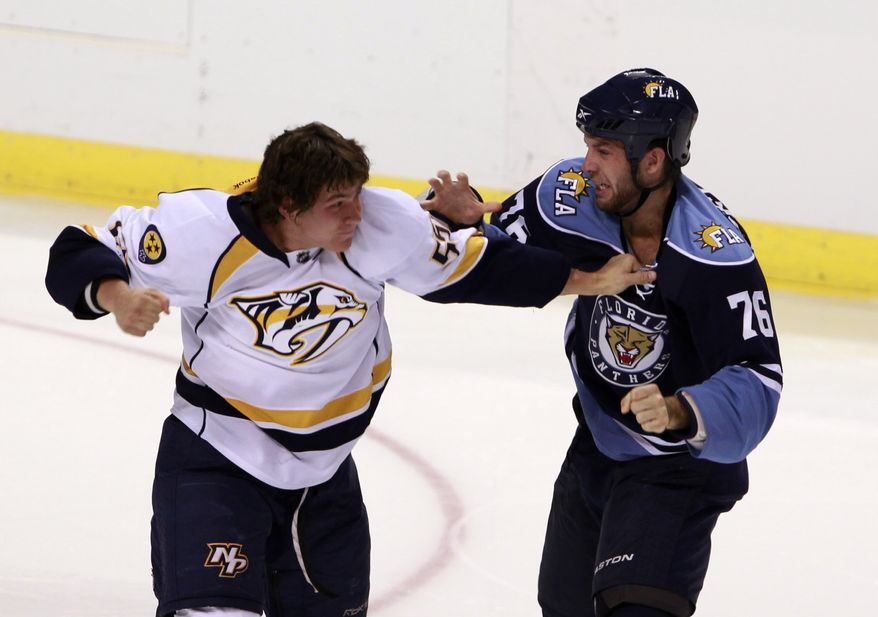 Florida Panthers right wing Anthony Luciani, right, and Nashville Predators center Michael Latta fight during the second period of the second of two preseason NHL hockey games, Monday, Sept. 19, 2011 in Sunrise, Fla. (AP Photo/Wilfredo Lee)