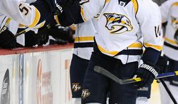 Nashville Predators right wing Martin Erat, of the Czech Republic, celebrates a goal by teammate Ryan Ellis with the bench in the first period of an NHL hockey game against the Colorado Avalanche on Tuesday, Jan. 10, 2012, in Denver. (AP Photo/Chris Schneider)