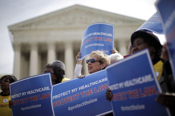 **FILE** Supporters of health care reform rally March 28, 2012, in front of the Supreme Court in Washington. (Associated Press)