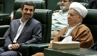 President Mahmoud Ahmadinejad (left) is not on the ballot in June's election. He is shown with supreme leader Ayatollah Ali Khamenei (center) and chief of the Expediency Council Akbar Hashemi Rafsanjani. (Associated Press)