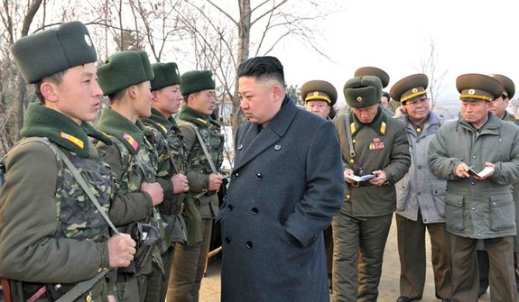 ** FILE ** Kim Jong-un inspects North Korea troops in this government photo.