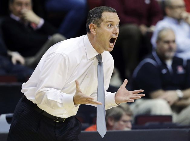 ** FILE ** In this Jan. 17, 2013, file photo, Rutgers head coach Mike Rice reacts to play during the first half of an NCAA college basketball game against South Florida in Piscataway, N.J. (AP Photo/Mel Evans, File)