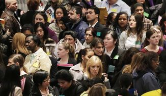 A crowd of job seekers attends a health care job fair in New York on Thursday, March 14, 2013. (AP Photo/Mark Lennihan)