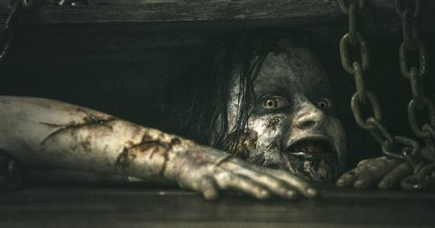 """This film image shows a scene from """"Evil Dead."""" (AP Photo/Sony-TriStar Pictures)"""