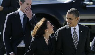 **FILE** President Obama walks with California Attorney General Kamala Harris (center) and California Lt. Gov. Gavin Newsom on Feb. 16, 2012, after arriving in San Francisco. (Associated Press)