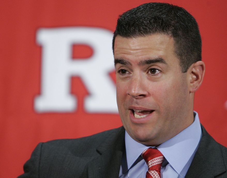 ** FILE ** In this Feb. 26, 2009, file photo, Tim Pernetti speaks to reporters after he was named the new athletic director at Rutgers University during a news conference on the university campus in Newark, N.J. A person familiar with the decision says Pernetti is out as Rutgers athletic director. (AP Photo/Mike Derer, File)