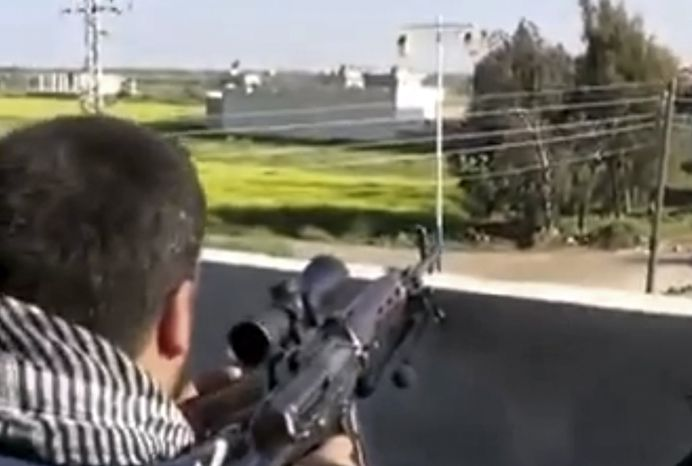 ** FILE ** In this Thursday, March 28, 2013, file image taken from video obtained from the Ugarit News, which has been authenticated based on its contents and other AP reporting, fighters from the Syrian Free Army fire on a Syrian army position in Deal less than 15 kilometers (10 mile