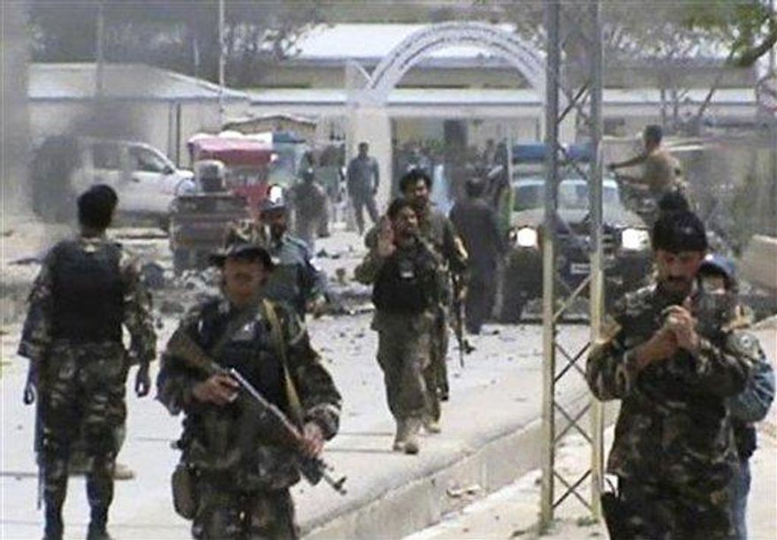 Afghan National Army soldiers rushing to the scene moments after a car bomb exploded in front the PRT, Provincial Reconstruction Team, in Qalat, Zabul province, southern Afghanistan, Saturday, April 6, 2013. Six American troops and civilians and an Afghan doctor were killed in attacks on Saturday in southern and eastern Afghanistan, officials said. (AP Photo via AP video)