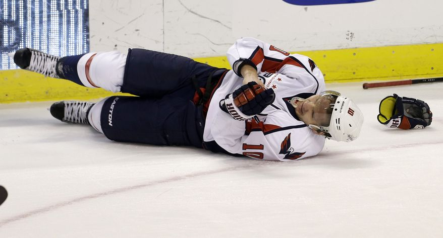 Washington Capitals' Martin Erat (10) lies injured during the first period of an NHL hockey game against the Florida Panthers in Sunrise, Fla., Saturday, April 6, 2013. (AP Photo/J Pat Carter)