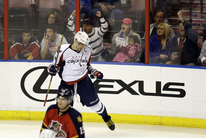 Fans, background, celebrate with Washington Capital's Alex Overchkin (8) after he scored a goal during the second period of an NHL hockey game against the Florida Panthers in Sunrise, Fla., Saturday, April 6, 2013. (AP Photo/J Pat Carter)