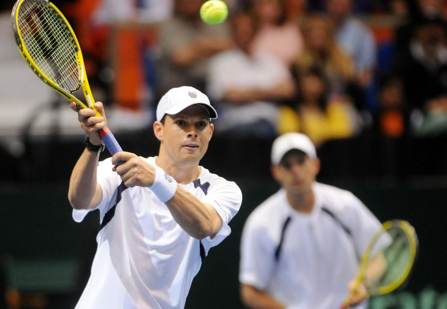 United States' Bob Bryan volleys the ball near the net during a Davis Cup quarterfinal doubles match with his brother Mike Bryan against Serbia's Ilija Bozoljac and Nenad Zimonjic on Saturday, April 6, 2013, in Boise, Idaho. Zimonjic and Bozoljac won 7-6 (5), 7-6 (1), 5-7, 4-6, 15-13. (AP Photo/Idaho Press-Tribune, Adam Eschbach)