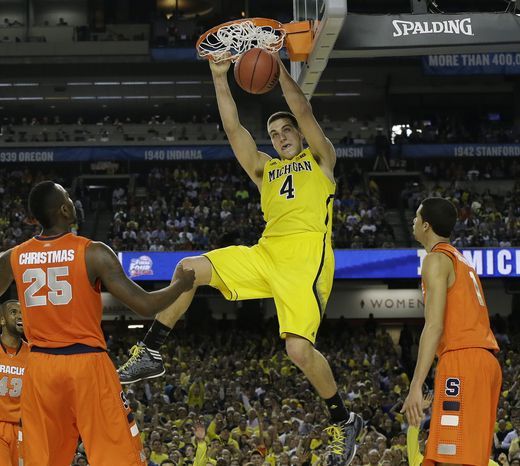 Michigan's Mitch McGary dunks the ball against Syracuse during the second half of the NCAA Final Four tournament college basketball semifinal game Saturday, April 6, 2013, in Atlanta. (AP Photo/Charlie Neibergall)
