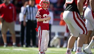 Jack Hoffman takes the field with the Husker football team in the fourth quarter Nebraska's spring NCAA college football game at Memorial Stadium in Lincoln, Neb., on Saturday, April 6, 2013. Hoffman, for whom Team Jack is named, suffers from pediatric brain cancer. (AP Photo/The Omaha World-Herald/Ryan Soderlin)