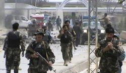 ** FILE ** Afghan National Army soldiers rush to the scene moments after a car bomb exploded in front the Provincial Reconstruction Team in Qalat in Afghanistan's Zabul province on April 6, 2013. (Associated Press)