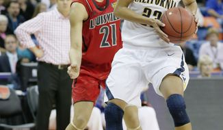 California guard Layshia Clarendon (23) drives against Louisville guard Bria Smith (21) in the first half of a national semifinal at the Women's Final Four of the NCAA college basketball tournament, Sunday, April 7, 2013, in New Orleans. (AP Photo/Dave Martin)