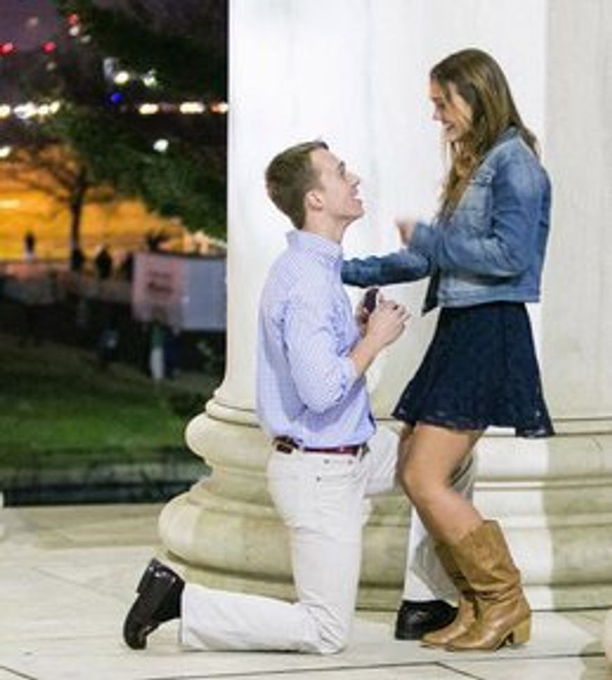 Kristin Hagelin smiles as her boyfriend Randy Carey proposes over Easter weekend at the Jefferson Memorial. The moment was a throwback to the chivalry often missing from modern relationships. (Alfredo Flores)