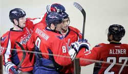 Washington Capitals left wing Alex Ovechkin (8), of Russia, celebrates his goal with teammates Matt Hendricks, left, Karl Alzner (27) and Mike Ribeiro (9) during the third period of an NHL hockey game against the Tampa Bay Lightning, Sunday, April 7, 2013, in Washington. The Capitals won 4-2. (AP Photo/Nick Wass)