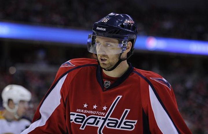 Washington Capitals right wing Eric Fehr (16) looks on during the second period of an NHL hockey game against the Buffalo Sabres, Sunday, March 17, 2013, in Washington. (AP Pho