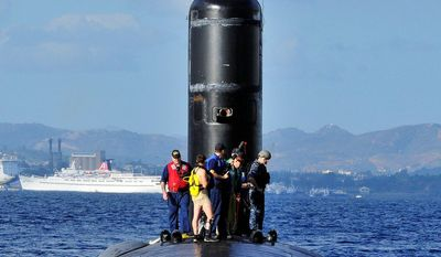 """Navy Lt. j.g. Marquette Leveque, 25, found a """"professional working environment"""" as one of the first female officers to train on guided- and ballistic-missile subs. (U.S. Navy photograph)"""