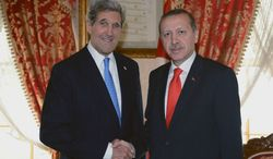 Turkish Prime Minister Recep Tayyip Erdogan (right) and U.S. Secretary of State John F. Kerry shake hands before a meeting in Istanbul on Sunday, April 7, 2013. Mr. Kerry will coordinate with Mr. Erdogan and other Turkish officials on efforts to halt the violence in neighboring Syria's civil war. (AP Photo/Kayhan Ozer, Turkish Prime Minister's Press Office)
