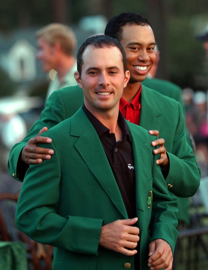 **FILE** Masters champion Mike Weir, from Canada, gets his Green Jacket from Tiger Woods, right, after winning the 2003 Masters at the Augusta National Golf Club in Augusta, Ga., Sunday, April 13, 2003. (AP Photo/Dave Martin)