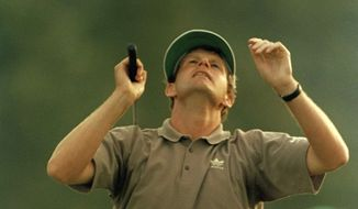 **FILE** Sandy Lyle reacts to the shot that won him the Masters Championship on the 18th hole at the Augusta National Golf Club, April 10, 1988. (AP Photo/Joe Benton)