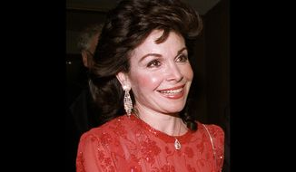 ** FILE ** In this Oct. 20, 1990, file photo, actress and former Mickey Mouse Club member Annette Funicello arrives for the 15th annual Italian American Foundation dinner in Washington. Walt Disney Co. said that Funicello, also known for her beach movies with Frankie Avalon, has died at age 70, Monday, April 8, 2013. (AP Photo/J. Scott Applewhite, File)