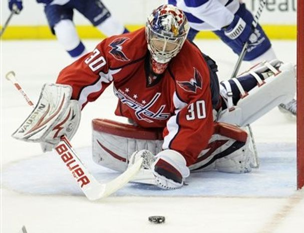 Michal Neuvirth stopped 28 of 30 shots in the Caps' April 7 victory over the Tampa Bay Lightning. (Associated Press)