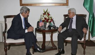 Palestinian President Mahmoud Abbas, right, meets with U.S. Secretary of State John Kerry in the West Bank city of Ramallah, Sunday, April, 7, 2013. (AP Photo / Mohamed Torokman)