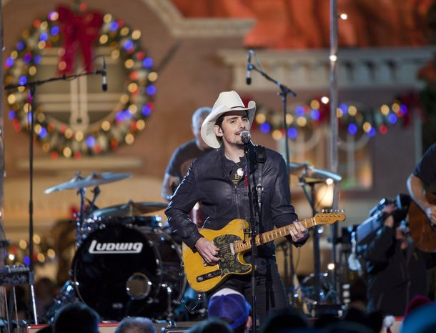 """**FILE** Brad Paisley tapes a performance for the """"Disney Parks Christmas Day Parade"""" TV special in Cars Land at Disney California Adventure park in Anaheim, Calif., on Dec. 20, 2012. (Associated Press/Disneyland, Paul Hiffmeyer)"""